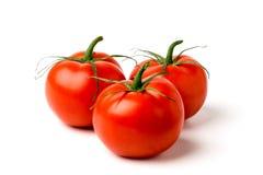 3 зрелых томата на белизне Стоковое фото RF