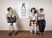 3 зрелища персоны нося в офисе на докторе Стоковые Фото