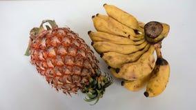 Зрелые банан и ананас Стоковые Изображения