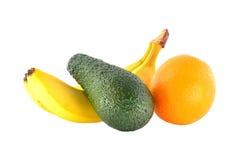 Зрелые банан, tangerine и авокадо Стоковые Изображения RF