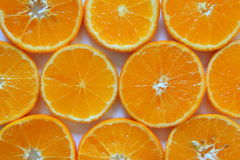 Зрелые и свежие мандарины закрывают вверх для предпосылки Стоковые Изображения