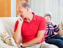 Зрелые пары после ссоры дома Стоковая Фотография