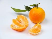 Зрелые сочные tangerines на белой предпосылке Стоковое Изображение