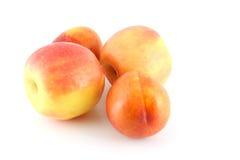 Зрелые яблоко и персики Стоковая Фотография