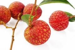 Зрелые lychees на белой предпосылке Стоковые Изображения