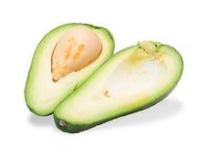 2 зрелых авокадоа, отрезок в одном Стоковое Изображение