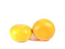 2 зрелых апельсина изолированного на белой предпосылке Стоковое Фото