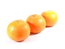 3 зрелых апельсина изолированного на белой предпосылке Стоковая Фотография