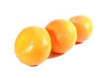 3 зрелых апельсина изолированного на белой предпосылке Стоковое Фото