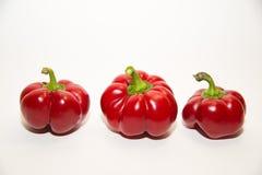 3 зрелых красного перца дальше над белизной Стоковая Фотография RF