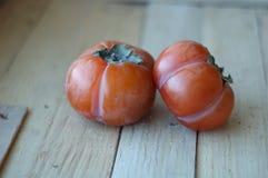 2 зрелых оранжевых хурмы Стоковые Фото
