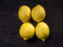 4 зрелых органических лимона Стоковые Изображения RF