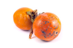 2 зрелых плодоовощ хурмы изолированного на белой предпосылке Стоковое Фото