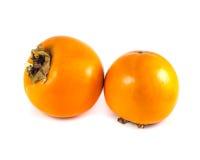 2 зрелых плодоовощ хурмы изолированного на белой предпосылке Стоковое Изображение