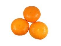 3 зрелых ярких апельсина цвета изолированного на белой предпосылке Стоковое Фото