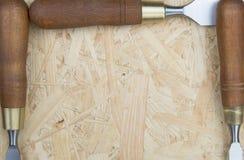 3 зубила на деревянной предпосылке Стоковая Фотография RF