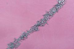 3 зубила на розовой предпосылке Стоковое Фото