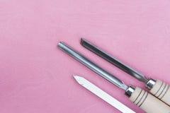 3 зубила на розовой предпосылке Стоковая Фотография