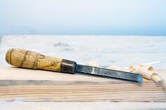 Зубило на деревянном баре Стоковые Фото