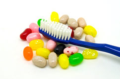 зубная щетка и конфеты Стоковое Фото