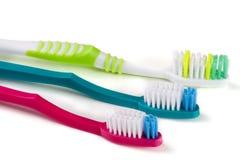 3 зубной щетки изолированной на белом крупном плане предпосылки Стоковое Фото