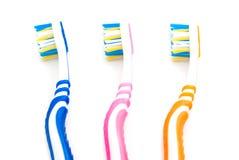 3 зубной щетки на белизне Стоковое Фото