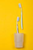 Зубные щетки на желтой предпосылке Стоковые Фотографии RF