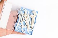 Зубоврачебные flossers на предпосылке белой бумаги стоковая фотография rf