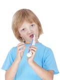 Зубы мальчика чистя щеткой Стоковое фото RF
