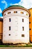 Здание высокорослого цилиндра форменное стоковое изображение