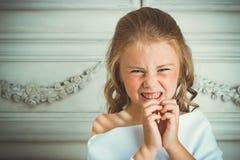 Злие эмоция и улыбка, меньший красивый ангел Стоковая Фотография RF