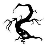 Злий хеллоуин смотрит на дерево Стоковое Фото