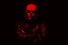 Злий человек на черной предпосылке Стоковые Фото