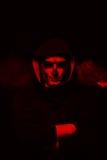 Злий человек на черной предпосылке Стоковые Изображения RF