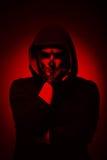 Злий человек на черной предпосылке Стоковое Фото