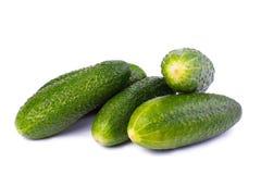 Здоровая еда. Зеленые огурцы изолированные на белой предпосылке Стоковая Фотография RF