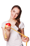 Здоровая счастливая женщина с яблоком и рулеткой стоковые фотографии rf