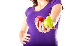 Здоровое диетпитание - женщина с яблоком и грушей Стоковое Изображение