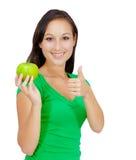 Здоровый образ жизни - счастливая женщина есть яблоко Стоковая Фотография