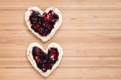 2 здравицы сформированных сердцем Стоковые Фото