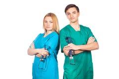 Здравоохранение и медицинская концепция - 2 доктора с стетоскопами Стоковое Изображение