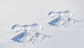 2 диаграммы в ангеле снега Стоковое фото RF