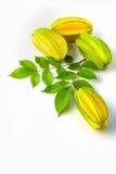 Играйте главные роли starfruit яблока карамболы или звезды на белой предпосылке Стоковое Изображение RF