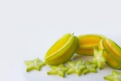 Играйте главные роли starfruit яблока карамболы или звезды на белой предпосылке Стоковые Изображения