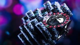 Играть в азартные игры в казино Предпосылка темы казино стоковое фото rf
