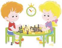 играть детей шахмат Стоковые Изображения