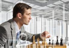 Играть его стратегию бизнеса стоковое фото rf