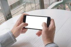 Играть игру на умном телефоне крупного плана eyedroppers высокий разрешения взгляд очень Стоковое фото RF