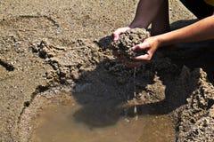 Играть песок в пляже Стоковое фото RF