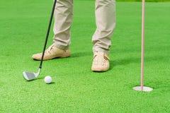 Играть человека гольфа в рамке Стоковое Фото